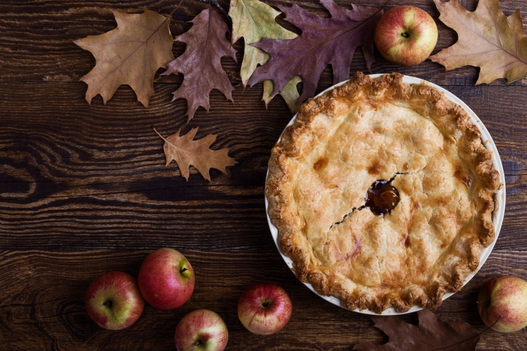 Overhead view of apple pie on rural wooden table
